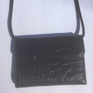 Croc-embossed faux leather clutch with strap